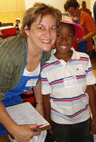 Back to School Store boy and volunteer