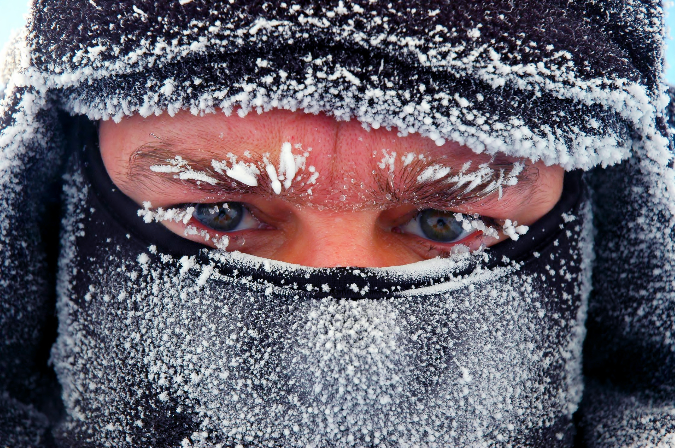 Man with ice and winter mask on face