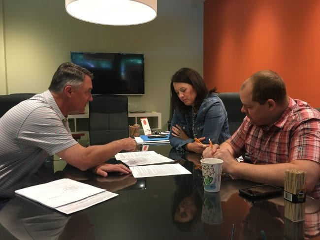 St Louis home buyer with lender at closing